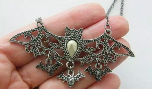 bat necklace back